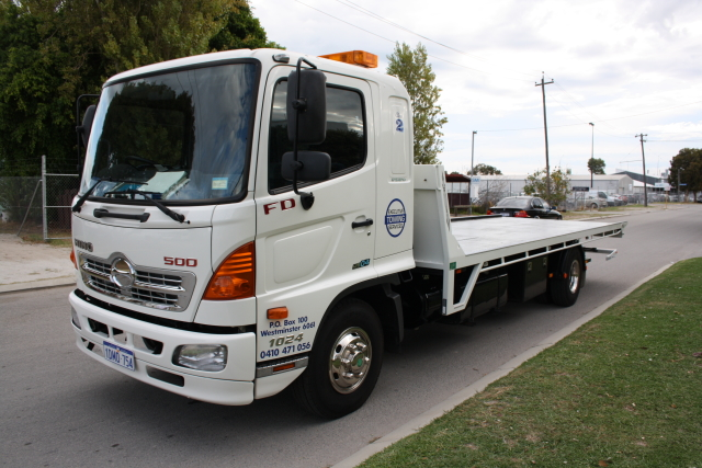 Executive Towing Services tilt tray truck