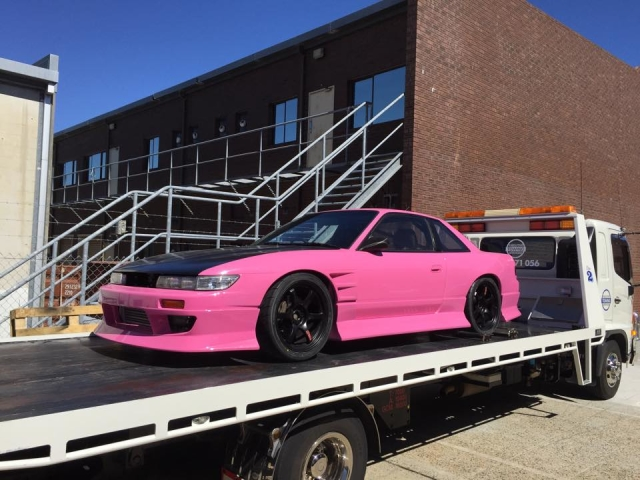 pink and black performance car on a tilt tray