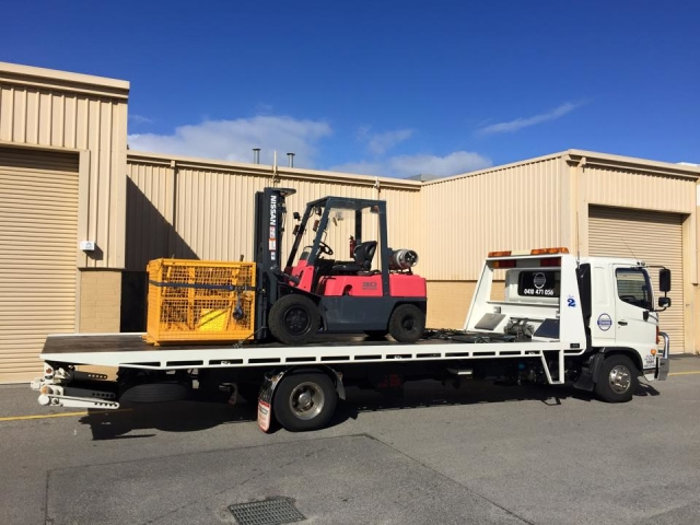 forklift truck on a tilt tray