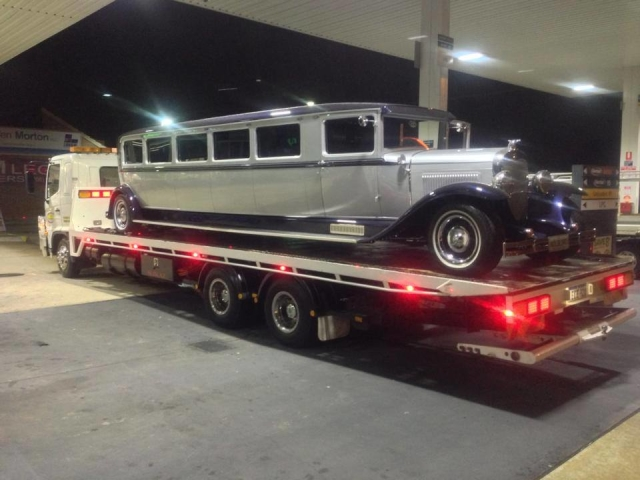 stretch classic car limo on a tilt tray truck in WA