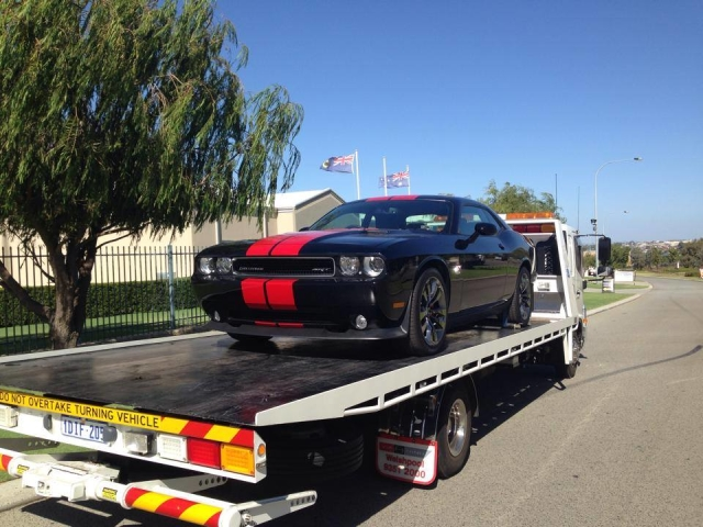 Corvette on a tilt tray truck in Perth