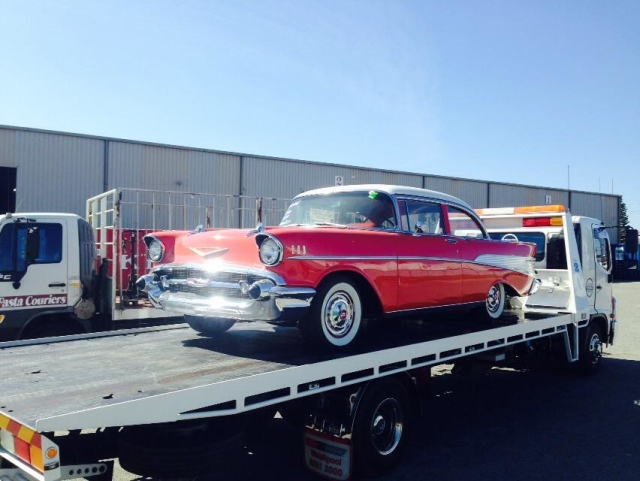 red classic car on a tilt tray in WA