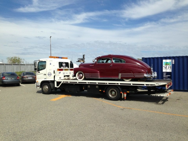 classic buick being transported by tilt tray in Perth
