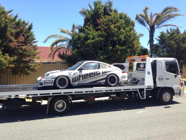 Race day track car transported by a tilt tray in Western Australia