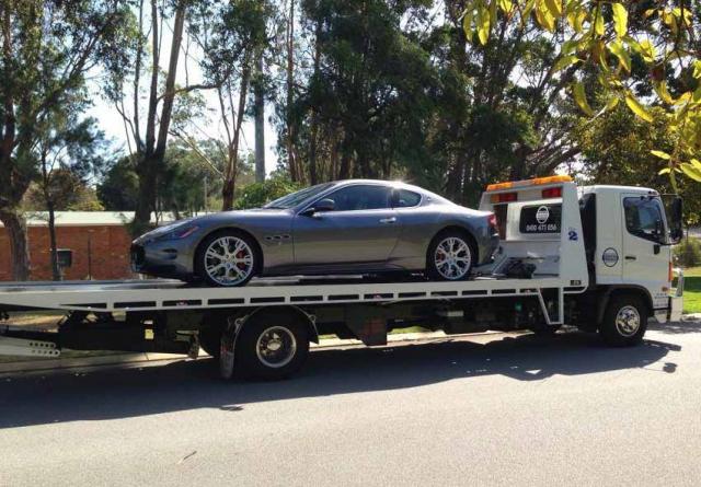 silver sports car on a tilt tray truck in western australia