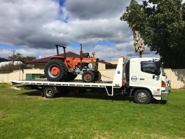 tractor on a hired tilt tray from executive towing perth