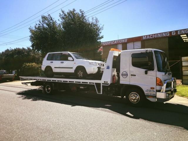 white vehicle on a tilt tray truck in western australia