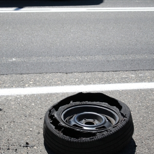 damaged tyre on the side of the road