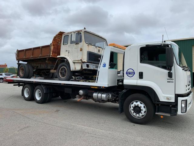 Tilt Tray Towing a Truck